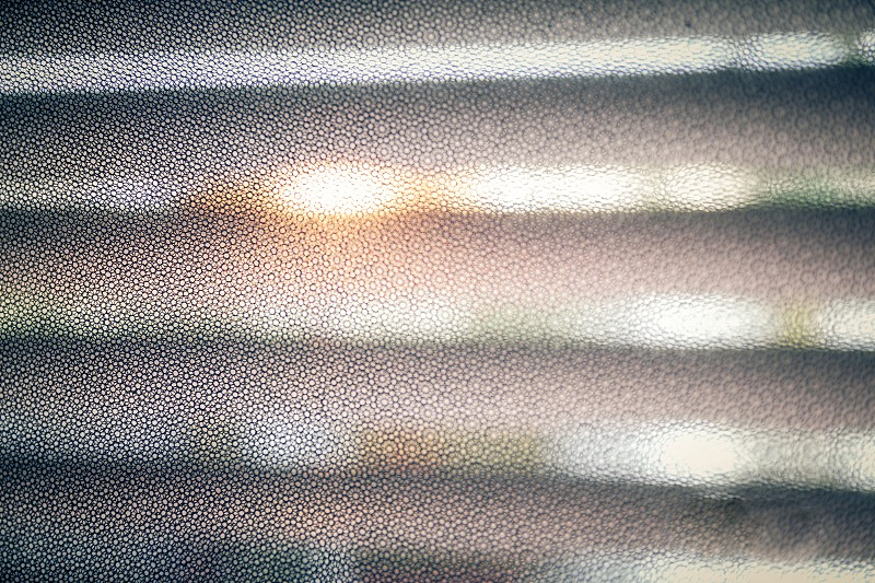 Black mesh pattern with a narrower focus.