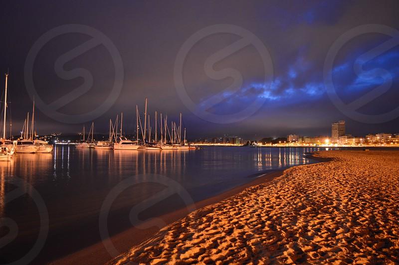 sailboats near seashore photo