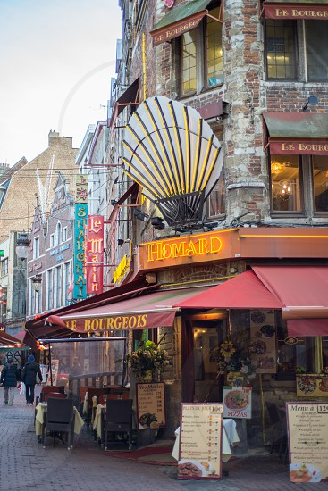 BRUSSELS BELGIUM -February 17 2014: small alley with many restaurants in Brussels Belgium photo