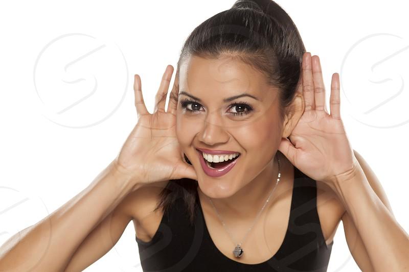 dark skinned beautiful happy woman listening carefully photo