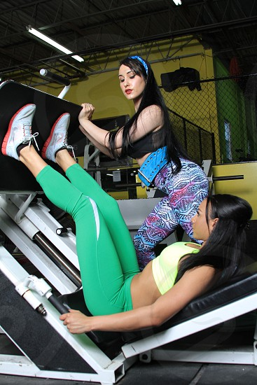 girls at the gym training legs photo