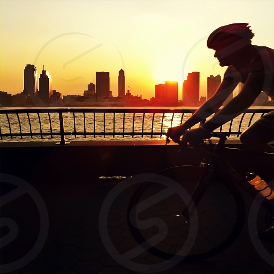 man riding a bicycle silhouette  photo