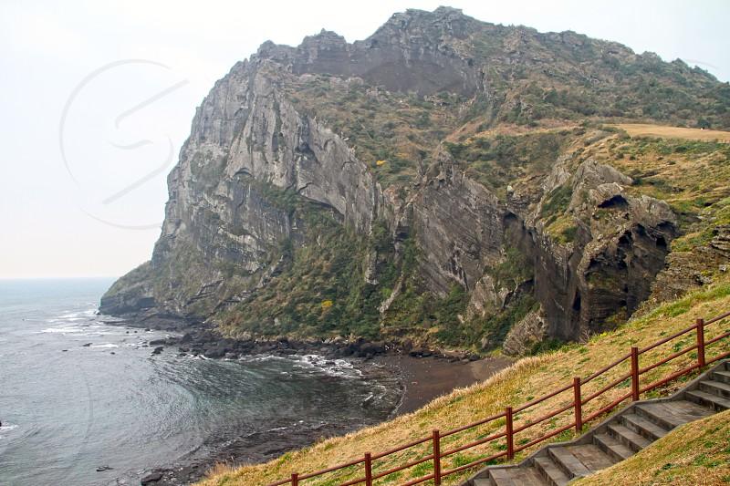 Seongsan Ilchulbong crater peak near the sea at the East part of Jeju island South Korea Asia. photo