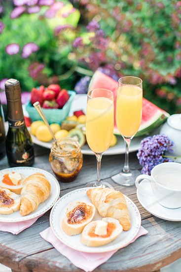 A mimosa brunch with pastries and coffee. photo
