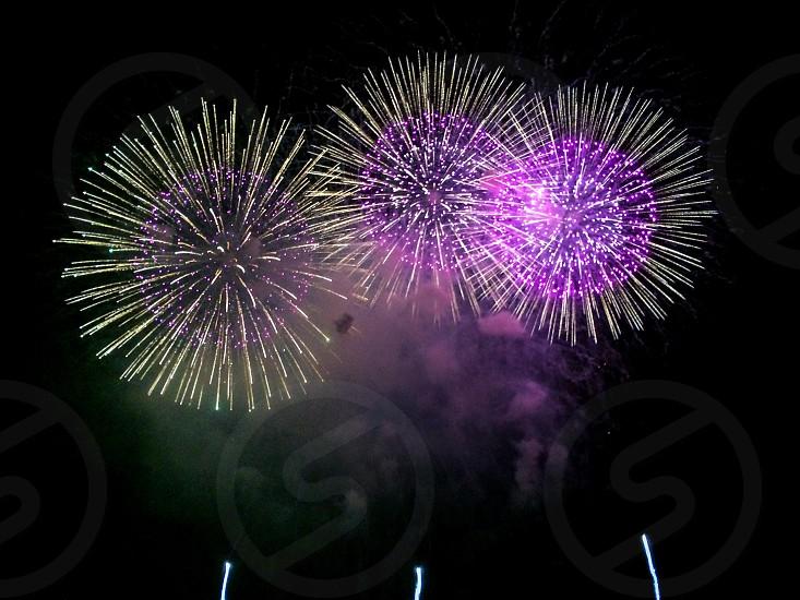 purple fireworks at night photo