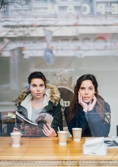 Twins womans drinking coffee photo
