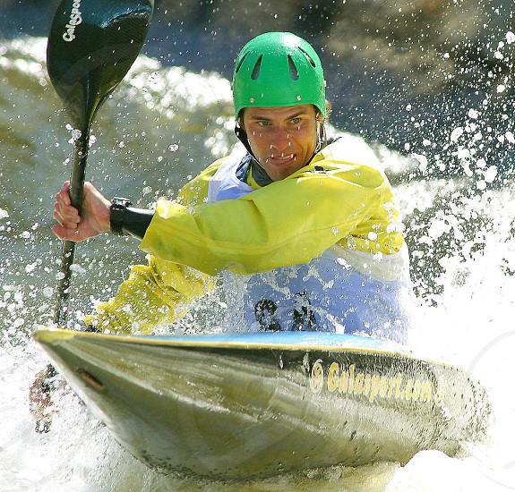 man on green kayak paddling during daytime photo