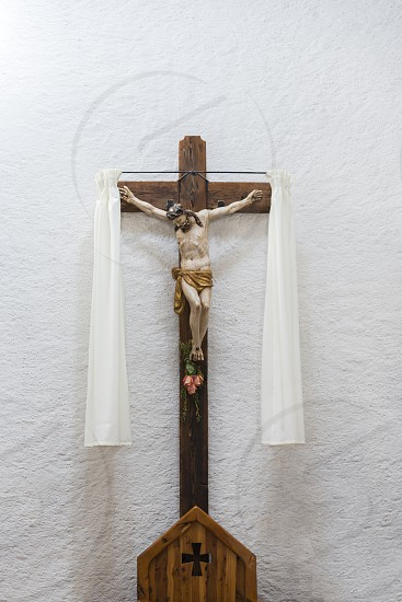 White wall in a church with Jesus Christ on the cross photo