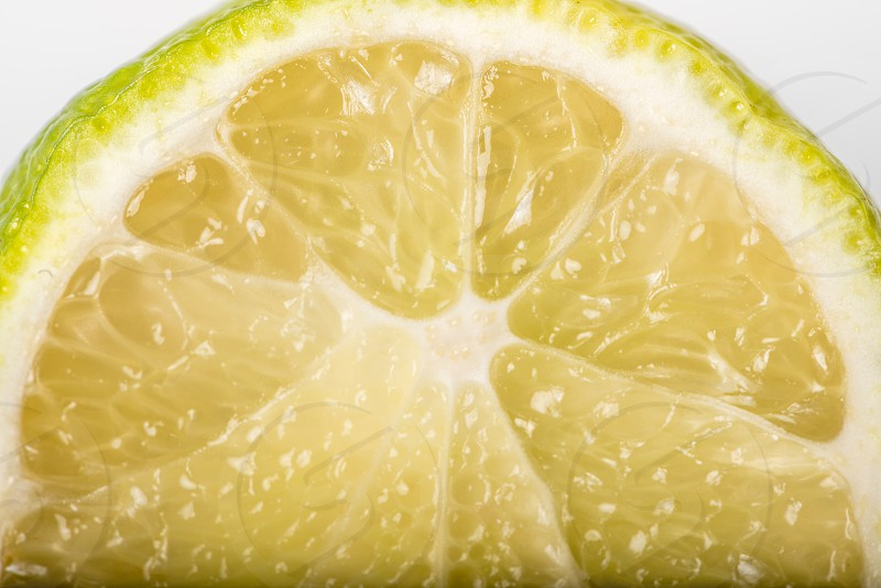 Macro shot of a sliced lime on a white plate. photo