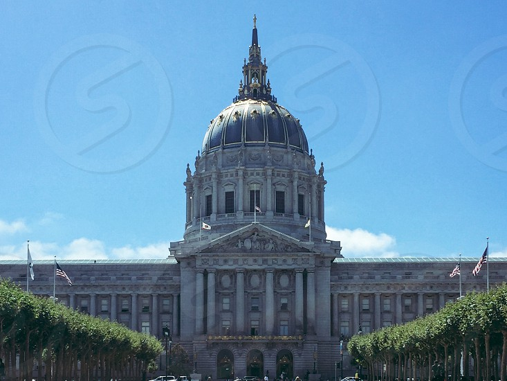 San Francisco's City Hall. A very symmetrical photo of the Capitol and part of the building and gardens. photo