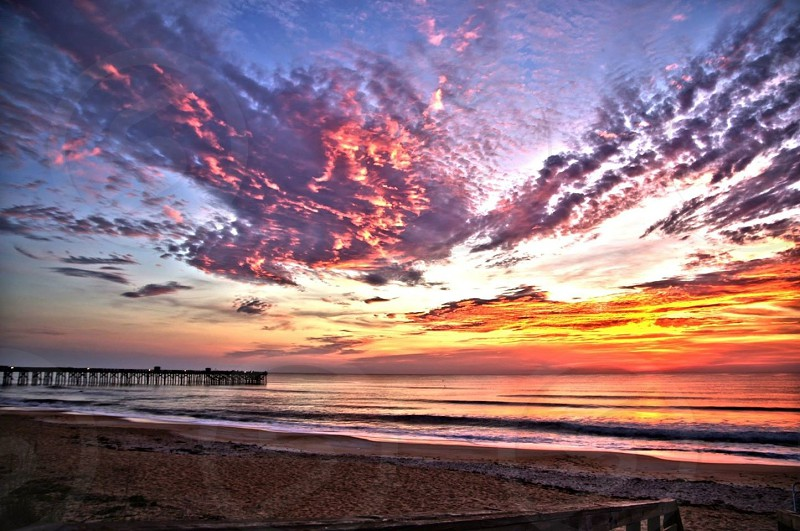 Sunrise morning Flagler Beach HDR pier Florida pink clouds sky beach color photo