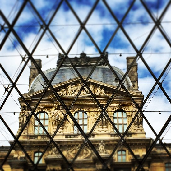 Looking out of the Pyramid onto the Louvre photo