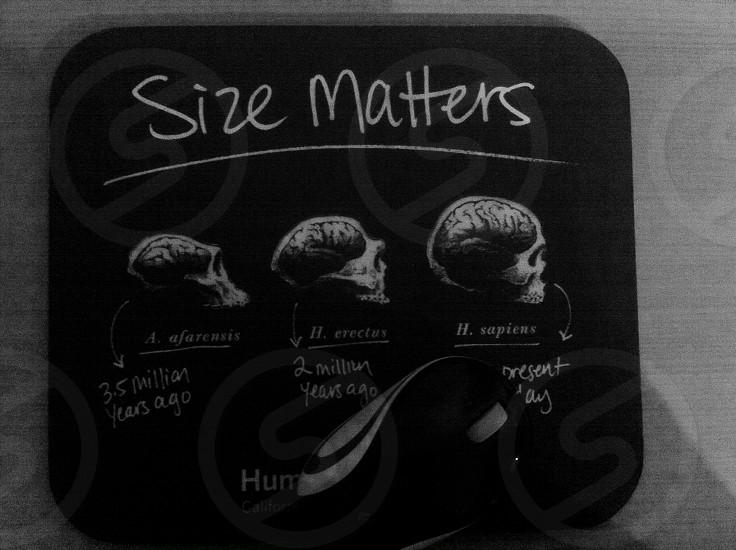 size matters printed black coaster photo