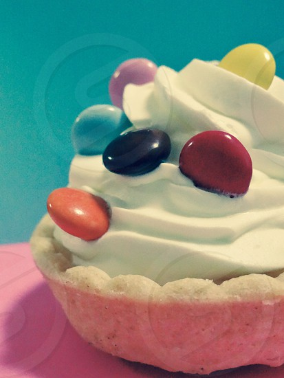 pie with whip cream and chocolate marbles photo
