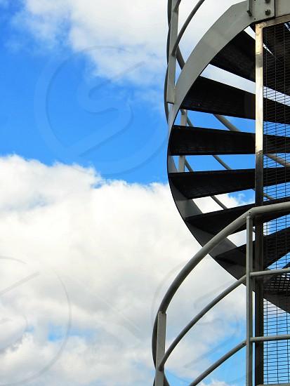 gray metal spiral stairs photo
