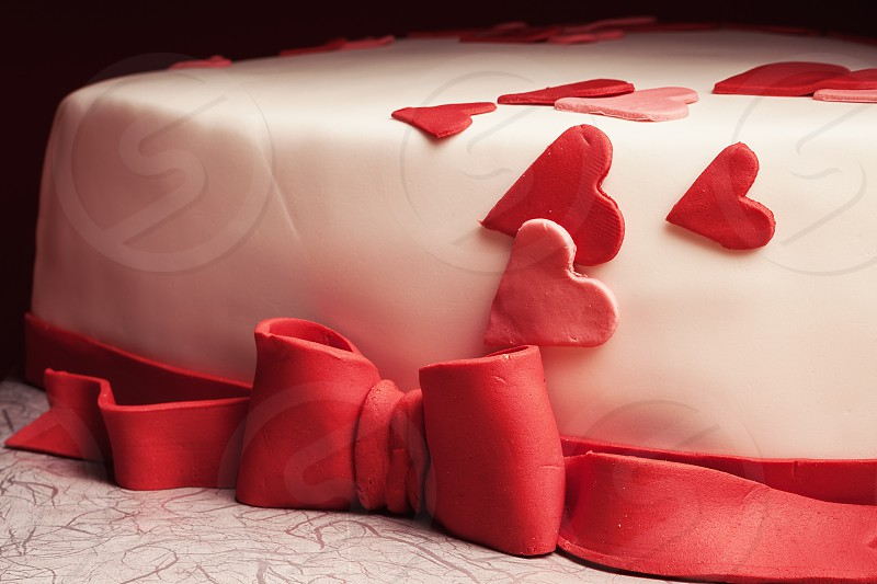 Details of a cake in shape of heart.  photo