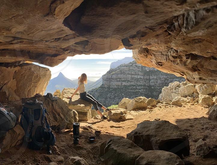 Relaxing in tea cave during rock climbing scrambling hike photo