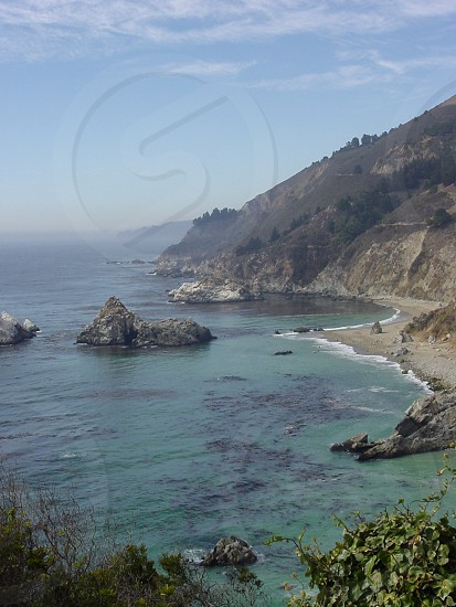 Driving the California Pacific Coast Highway RTE 101. The scenery is spectacular. Carmel CA outside of Monterrey CA photo