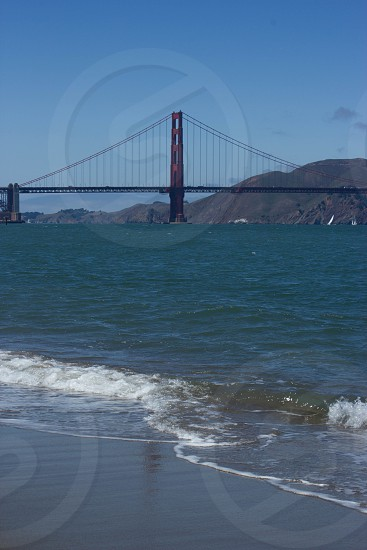 shoreline and golden gate bridge as background photo photo