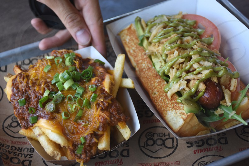 hotdog sandwich beside fried fries photo