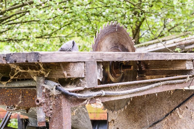 Every farm has its old DIY tools. Circular saw. photo