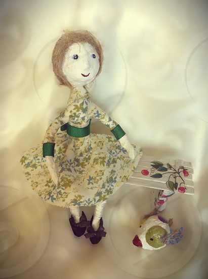 doll with black shoes with bows and green ribbed cuff dress with floral design photo