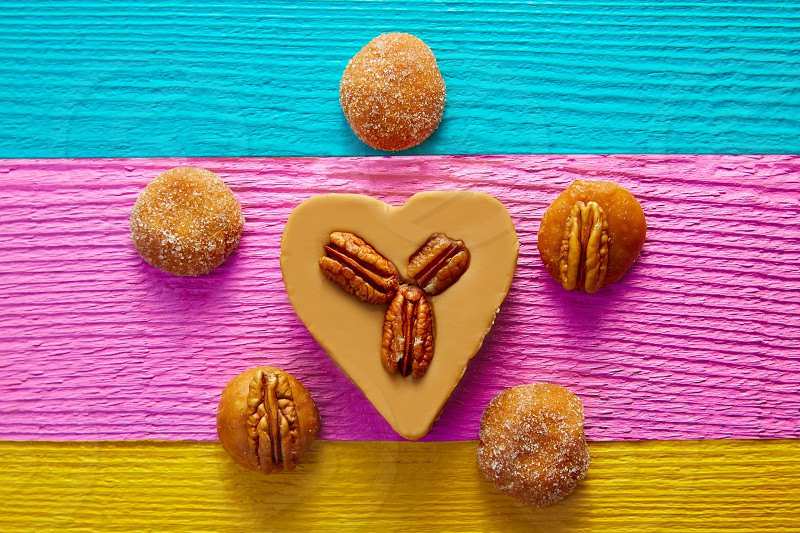 Mexican candy sweets cajeta heart with pecan nuts photo