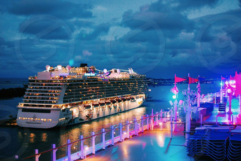 Cruise Ship Boat Sunset Lights Dusk VSCO reflections Caribbean Water The Bahamas Clouds Sky photo
