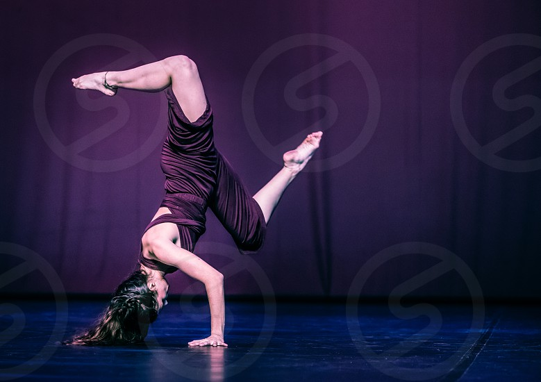 Woman Modern Dancer Doing Acrobatics On Stage photo