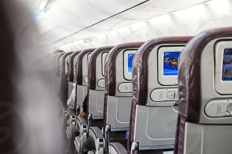 Rear view of inflight economy class cabin seats of an airplane. photo