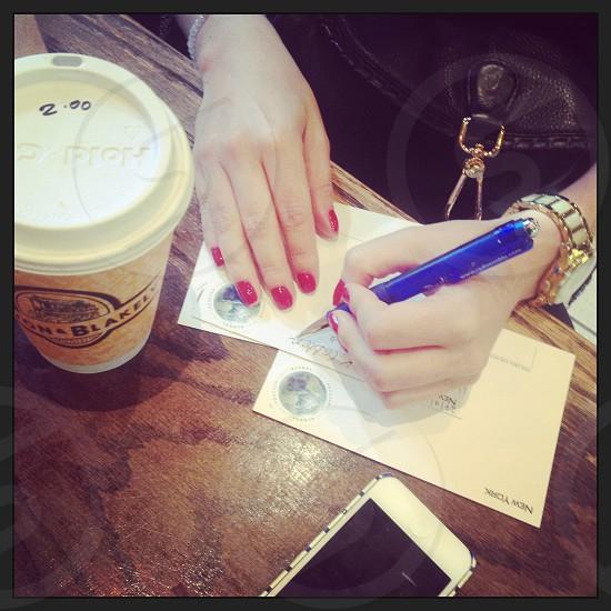 New York City street view Manhattan writing postcards at coffee shop photo