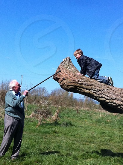 Grandson being shown how to do it properly. This is a real moment captured between my father in law and son a couple of years ago.  photo