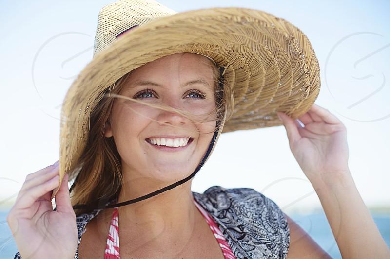 woman wearing straw hat smiling photo