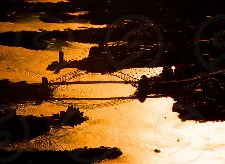 Golden Sydney Harbour Sunset. sydney bridge australia water golden sunset reflection opera house opera house aerial flying boats harbour harbour late evening afternoon photo