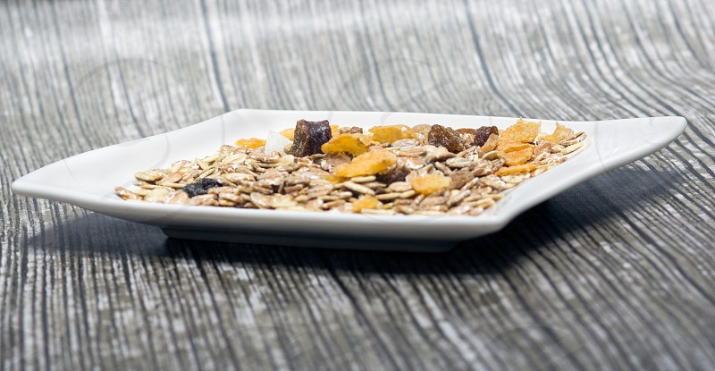 breakfast; cereal; food; bowl; healthy; corn; meal; milk; muesli; grain; flakes; nutrition; cornflakes; diet; white; isolated; background; morning; sweet; vegetarian; flake; dairy; oat; snack; fruit; organic; yellow; dry; fresh; health; nobody; fiber; crunchy; energy; eating; granola; ingredient; brown; sugar; serving; oatmeal; wheat; dish; table; full; tasty; lifestyle; natural; strawberry; wooden photo
