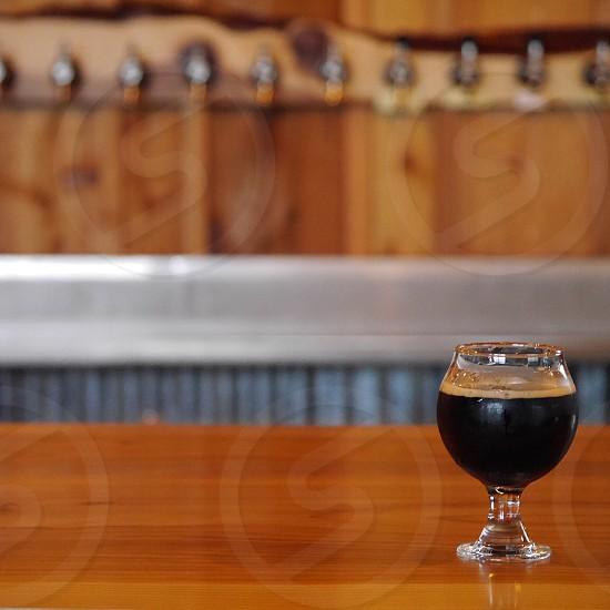 Craft beer on wood bar; Portland Oregon photo