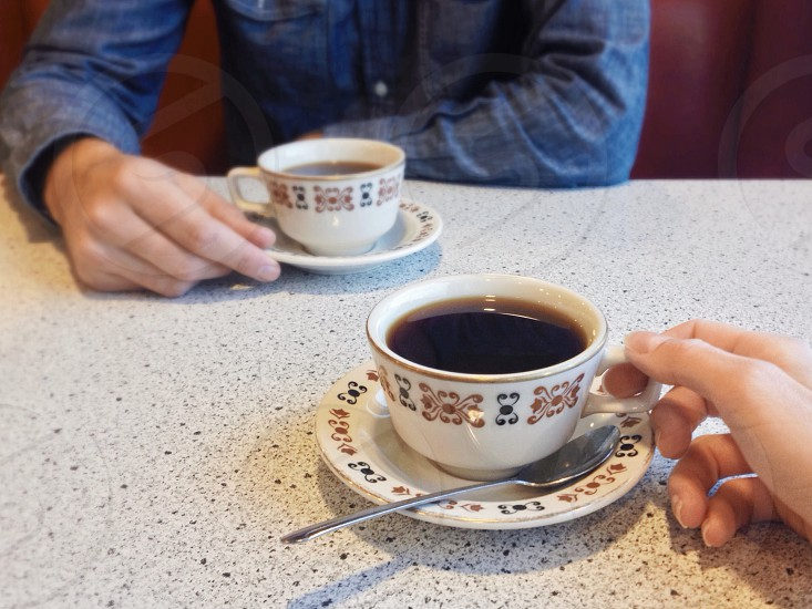 Meeting over coffee at a diner. photo