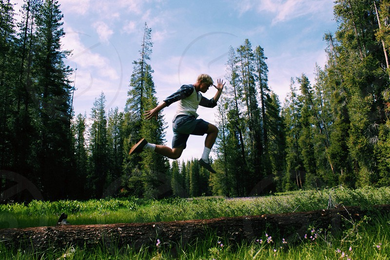 man in white vest jumping photo