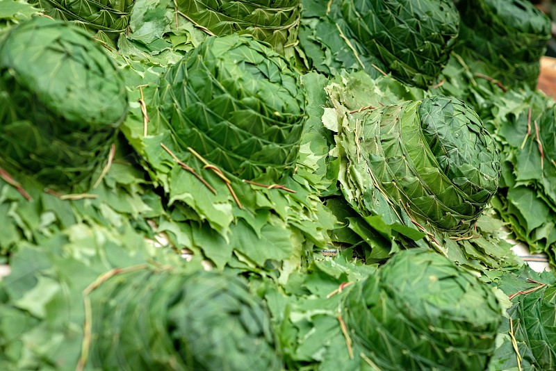A hat made of green leafs. Close-up photograph. photo