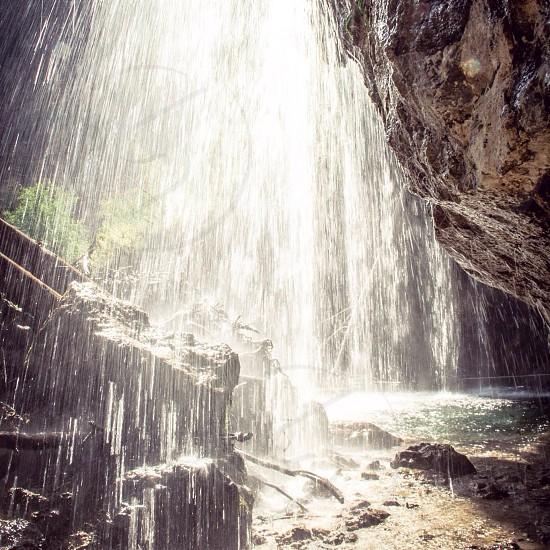 Underneath the waterfall at Hanging Lake Glenwood Canyon Colorado.  photo