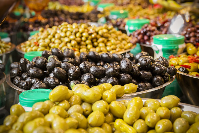 Olives at a market stall. A variety of types of olives. Green black Syrians and others. photo