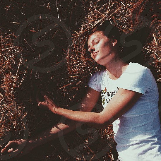 woman wit white tshirt in the grass photo