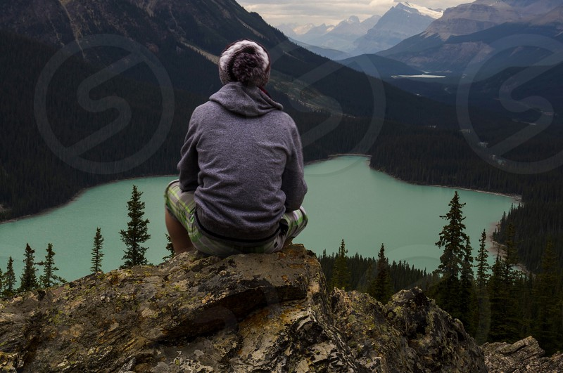 man sitting on hill in Banff National Park photo
