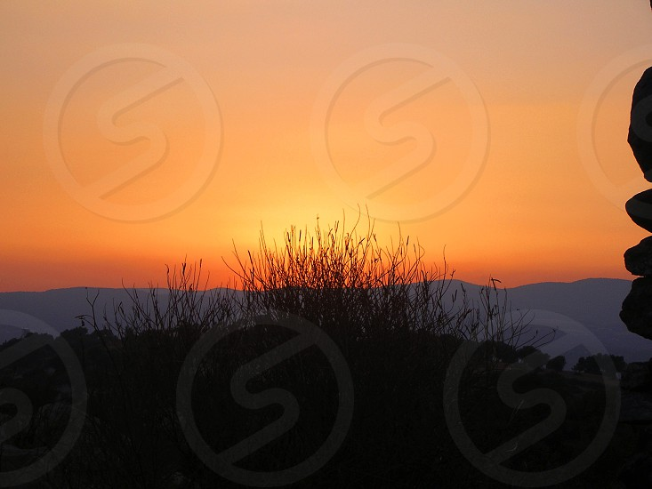 view of sunset at the mountain photo