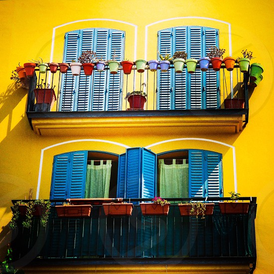 Color colors colorful yellow window windows architecture doors balcony pots home  photo
