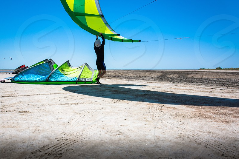 view of person fixing parachute photo