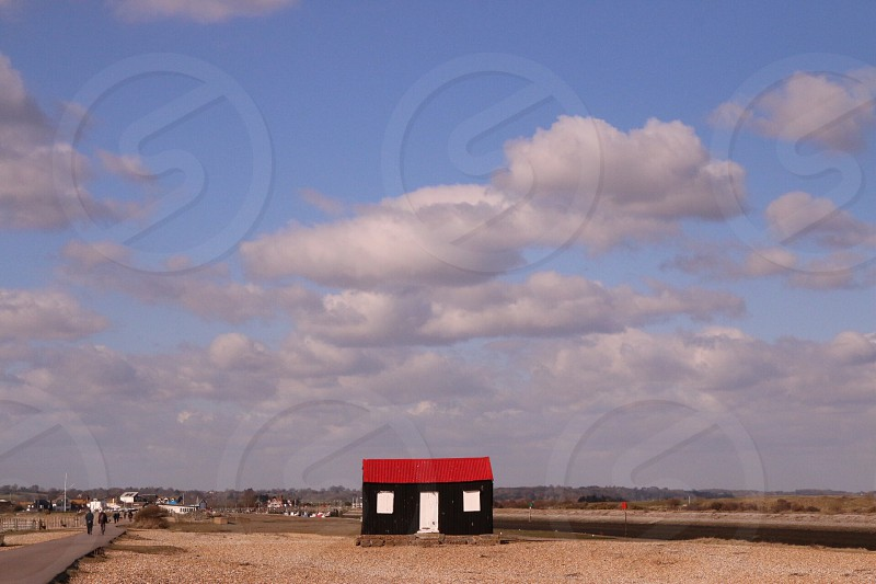 Beach seaside sea hut house fisherman cottage fish Sky cloud sand shingle pebble England rye camber Coast beautiful stunning lonely isolated photo