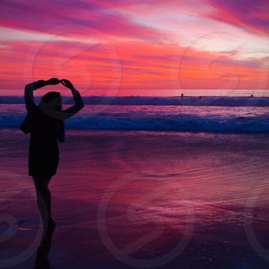 woman in ballet position with sunset view photo