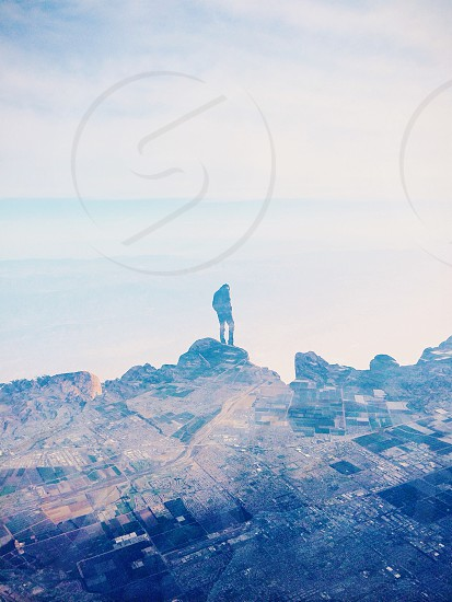 man on top of mountain silhouette photo