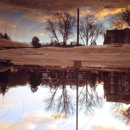 sidewalk view reflection through water photo